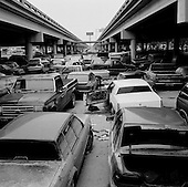 New Orleans, Louisiana.USA.February 20, 2006..Thousands of cars damages from the levee break/flood after Katrina are stored under highway 610 in central New Orleans...