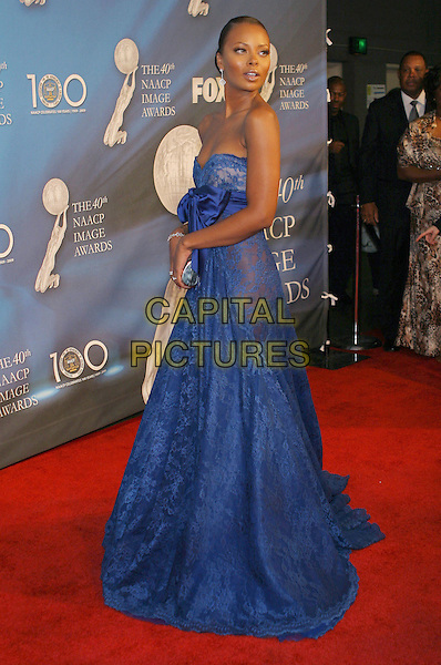 EVA MARCILLE PIGFORD.40th Annual NAACP Image Awards held at the Shrine Auditorium, Los Angeles, California, USA..February 12th, 2009.full length blue lace strapless dress sash waist silver clutch bag gown looking over shoulder .CAP/ADM/TC.©T. Conrad/AdMedia/Capital Pictures.