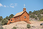 Wooden historic Catholic church on the hill, clouds (moved to Manhattan, Nev.,  in the late 1800s from Belmont)