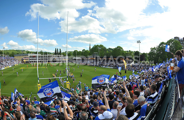 Bath Rugby fans in the crowd wave flags in support prior to kick off. Aviva Premiership semi-final, between Bath Rugby and Leicester Tigers on May 23, 2015 at the Recreation Ground in Bath, England. Photo by: Patrick Khachfe / Onside Images