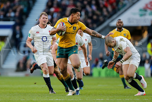 03.12.2016. Twickenham, London, England. Autumn International Rugby. England versus Australia. Israel Folau of Australia fails to hand off Mike Brown of England.