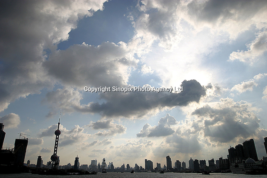 The super modern skyline seen from the Huangpu River  in Shanghai, China.  Shanghai is a marval of modern design and architecture but this has come at a high price as tradition and culture are being sacrificed..