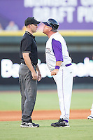 Winston-Salem Dash manager Tommy Thompson (39) gets in the face of umpire Ben Levin after having been ejected for arguing a call at third base during the game against the Myrtle Beach Pelicans at BB&T Ballpark on July 16, 2014 in Winston-Salem, North Carolina.  The Pelicans defeated the Dash 6-2.   (Brian Westerholt/Four Seam Images)