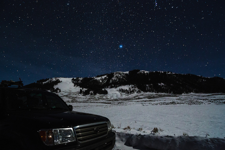 A 2004 Toyota Land Cruiser is seen under the stars along the road in Yellowstone National Park, Wyoming.