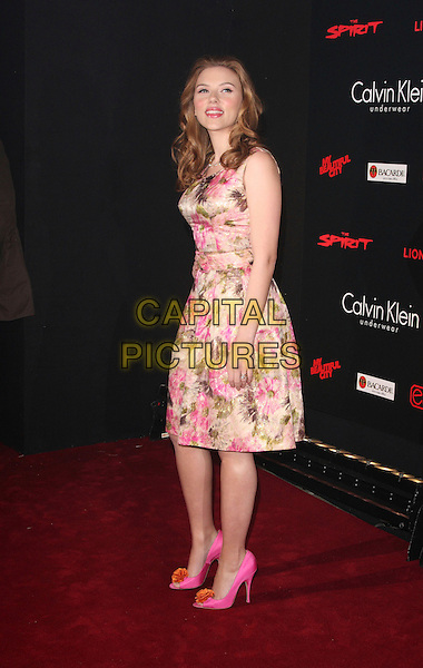 "SCARLETT JOHANSSON .At the launch party for ""The Spirit"" at the The Old Sorting Office in London, England, December 4th 2008..full length dress belt pink gold green floral print sleeveless necklace gold   orange flower corsage shoes peep toe open heels .CAP/ROS.©Steve Ross/Capital Pictures"