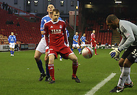 Mark Reynolds shields the ball back to Jason Brown under pressure from Tom Brighton in the Aberdeen v Queen of the South William Hill Scottish Cup 5th Round match played at Pittodrie Stadium, Aberdeen on 4.2.12..