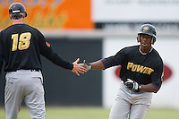 West Virginia Power manager Gary Green #18 slaps hands with Quincy Latimore #22 following his home run versus the Hickory Crawdads at L.P. Frans Stadium June 21, 2009 in Hickory, North Carolina. (Photo by Brian Westerholt / Four Seam Images)