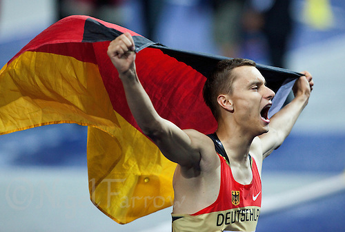 21 AUG 2009 - BERLIN, GER - Raul Spank (GER) celebrates his medal at the Mens High Jump Final at the World Athletics Championships (PHOTO (C) NIGEL FARROW)