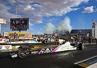 Nov 2, 2014; Las Vegas, NV, USA; NHRA top alcohol dragster driver Ashley Sanford (near lane) races alongside Johnny Ahten during the Toyota Nationals at The Strip at Las Vegas Motor Speedway. Mandatory Credit: Mark J. Rebilas-USA TODAY Sports