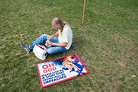 "A sign reading ""OH GOD / Please Give me a sign that Trump will be impeached"" lays on the ground as people gather to observe the solar eclipse in the Kresge Oval and outside the Stratton Student Center at MIT in Cambridge, Massachusetts, USA, on Mon., Aug. 21, 2017. This solar eclipse is the first in nearly 40 years to have a path observable total eclipse from coast to coast in the United States. People at this location in Massachusetts, however, only observed about 66% coverage of the moon over the sun. MIT set up telescopes to safely observe the eclipse, in addition to homemade camera obscura and pinhole viewers and eclipse glasses."