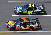 Apr 25, 2008; Talladega, AL, USA; NASCAR Sprint Cup Series driver Jeff Gordon (24) races alongside Martin Truex Jr (1) during practice for the Aarons 499 at Talladega Superspeedway. Mandatory Credit: Mark J. Rebilas-US PRESSWIRE