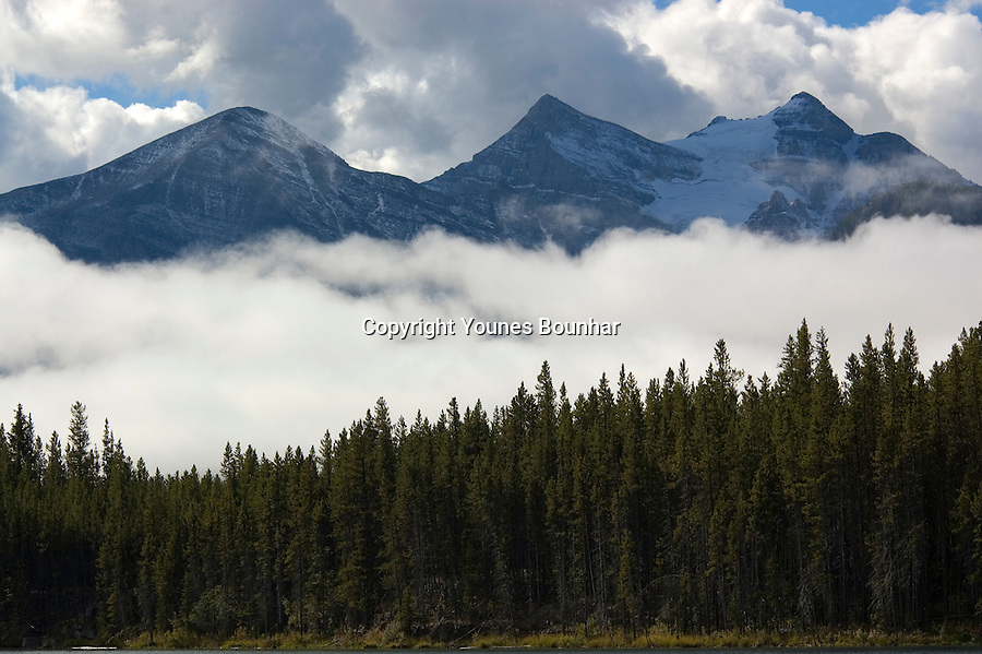 Low clouds roll out in the early morning clearing Victoria Glacier as seen from Herbert Lake