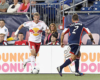 New York Red Bulls defender Jan Gunnar Solli (8) brings the ball forward. Despite a red-card man advantage, in a Major League Soccer (MLS) match, the New England Revolution tied New York Red Bulls, 1-1, at Gillette Stadium on September 22, 2012.