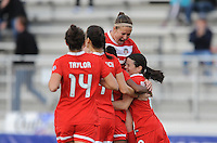 Boyds MD - April 19, 2014: Diana Matheson (8) of the Washington Spirit celebrates her score with teammates. The Washington Spirit defeated the FC Kansas City 3-1 during a regular game of the 2014 season of the National Women's Soccer League at the Maryland SoccerPlex.