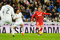 Real Madrid´s Marcelo Vieira and Sevilla's Gerard Lazaro during 2014-15 La Liga match between Real Madrid and Sevilla at Santiago Bernabeu stadium in Alcorcon, Madrid, Spain. February 04, 2015. (ALTERPHOTOS/Luis Fernandez) /NORTEphoto.com