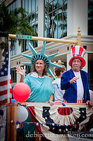 Mrs. Liberty and Uncle Sam wave along to cheering fans along 5th Avenue South during the Fourth of July Parade, Naples, Florida, USA. Photo by Debi PIttman Wilkey
