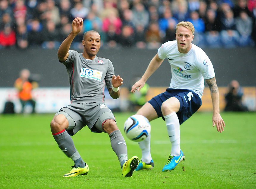 Rotherham United's Wes Thomas shields the ball from Preston North End's Tom Clarke <br /> <br /> Photographer Chris Vaughan/CameraSport<br /> <br /> Football - The Football League Sky Bet League One Play-Off First Leg - Preston North End v Rotherham United - Saturday 10th May 2014 - Deepdale - Preston<br /> <br /> &copy; CameraSport - 43 Linden Ave. Countesthorpe. Leicester. England. LE8 5PG - Tel: +44 (0) 116 277 4147 - admin@camerasport.com - www.camerasport.com
