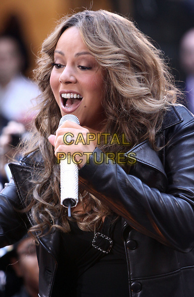 "MARIAH CAREY .performs live on NBC's ""TODAY Show"", New York, NY, USA, .2nd October 2009..concert music gig on stage performing half length microphone curly wavy hair black leather  diamante sparkly rhinestone jewel encrusted  ring singing .CAP/ADM/PZ.©Paul Zimmerman/Admedia/Capital Pictures"