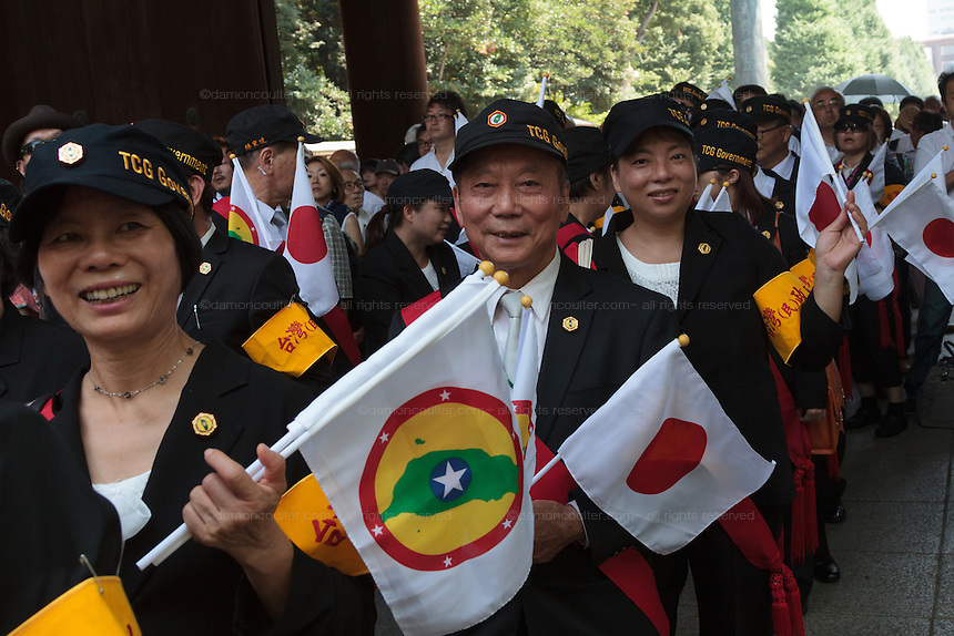 Members of the Taiwan Civil Government Group line up to pray during the 70th anniversary celebrations of the end of the Pacific war  at the controversial Yasukuni Shrine in Kudanshita, Tokyo, Japan Saturday August 15th 2015 The Taiwan Civil Government group call for the return of the Island of Taiwan to the Japanese Empire.