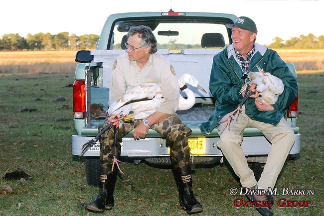 Steve & George Holding Whooping Cranes