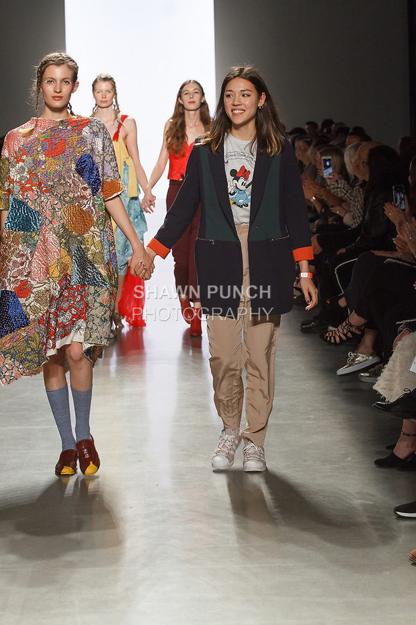 Graduating design student Jessie Sodetz, walks runway with model at the close of 2017 Pratt fashion show on May 4, 2017 at Spring Studios in New York City.