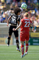 Eriko Arakawa (30) and Becky Sauerbrunn (22) jump for the ball. FC Gold Pride defeated Washington Freedom 3-2 at Buck Shaw Stadium in Santa Clara, California on August 1, 2009.