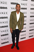 "LONDON, UK. October 31, 2018: Reggie Yates at the ""Widows"" special screening in association with Vogue at the Tate Modern, London.<br /> Picture: Steve Vas/Featureflash"