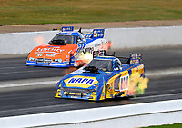 May 6, 2017; Commerce, GA, USA; NHRA funny car driver Ron Capps (near) races alongside Jim Campbell during qualifying for the Southern Nationals at Atlanta Dragway. Mandatory Credit: Mark J. Rebilas-USA TODAY Sports