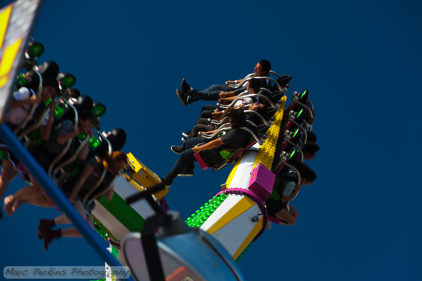 Four riders are flung backwards through the air on the Tango, a carnival ride at the 2011 Orange County Fair.  I love the sense of frozen motion and captured moment of enjoyment in this picture.
