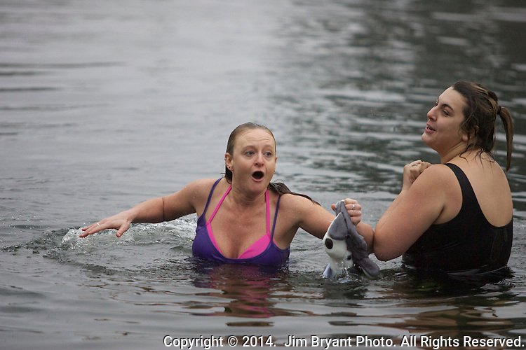 Participants hurl off the bridge into the Burley Lagoon during the 30th annual Polar Bear in  Olalla, Washington on January 1, 2014. Over over a period of three hours more than 450 hardy participants jumped into the frigid waters for the annual Polar Bear Plunge into the chilly lagoon waters to join in on the annual New Year's Day Tradition. ©2014. Jim Bryant Photography. All Rights Reserved