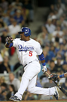 Juan Uribe #5 of the Los Angeles Dodgers bats against the Chicago Cubs at Dodger Stadium in Los Angeles, California on May 3, 2011. Photo by Larry Goren/Four Seam Images