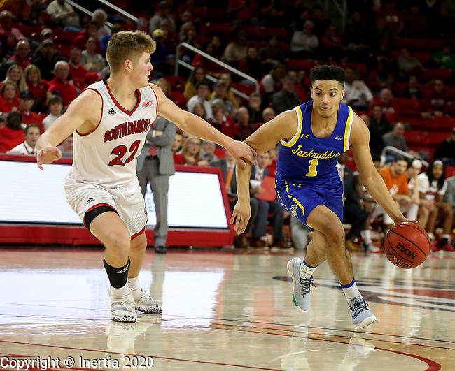 VERMILLION, SD - JANUARY 19: Matt Mims #1 of South Dakota State Jackrabbits looks to get a step past Tyler Peterson #22 of South Dakota Coyotes at the Sanford Coyote Center on January 19, 2020 in Vermillion, South Dakota. (Photo by Dave Eggen/Inertia)