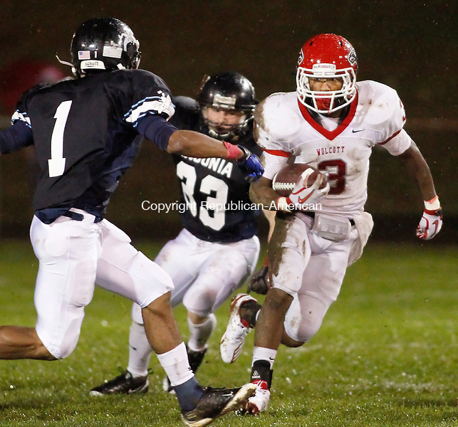 Ansonia, CT- 15, October 2010-101510CM14 Wolcott's DeVante Bonnvillian picks up yardage against Ansonia defenders, Miky Mason (#1) and Dennis Danley (#33) Friday night in Ansonia.  Chargers went onto win, 39-20.  Christopher Massa Republican-American