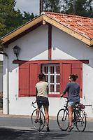 France, Aquitaine, Pyrénées-Atlantiques, Pays Basque, Urt: le port , cyclistes //  France, Pyrenees Atlantiques, Basque Country, Urt: cyclist