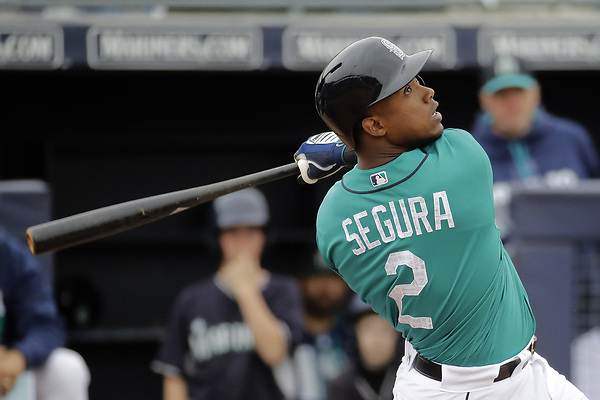 Seattle Mariners' Jean Segura bats during the second inning of a spring training baseball game against the Kansas City Royals Monday, Feb. 27, 2017, in Peoria, Ariz. (AP Photo/Charlie Riedel)
