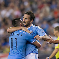 Foxborough, Massachusetts - July 6, 2016: In a Major League Soccer (MLS) match, New York City FC (blue/white) defeated  New England Revolution (red), 1-0, at Gillette Stadium.<br /> Goal celebration.