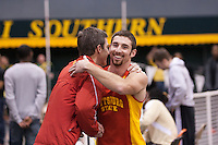 Pittsburg State junior Colbie Snyder is congratulated by Coach Russ Jewitt after clearing 16-10, a personal record and nationals automatic qualifying mark in winning the pole vault at the 2012 MIAA Indoor Track & Field Championships at Missouri Southern State University in Joplin, MO February, 26.