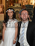 Mia Carolan from Scoil Aonghuasa who recieved First Holy Communion at St. Peter's church with Master Aonghus Rooney. Photo:Colin Bell/pressphotos.ie