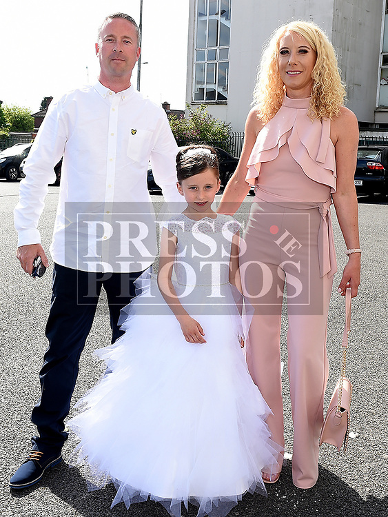 Abi McAllister from St Brigids school who received her Fiirst Holy Communion in Our Lady of Lourdes church pictured with parents Mark and Louise. Photo:Colin Bell/pressphotos.ie