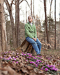 February 2, 2012. Hillsborough, NC.. Nancy Goodwin sits for a portrait in a bed of .  Nancy Goodwin, who used to run a mail order nursery for rare bulbs, has now preserved her gardens, which in winter, have thousands of blooming flowers and plants, including many rare species which she has cultivated and planted from seeds.