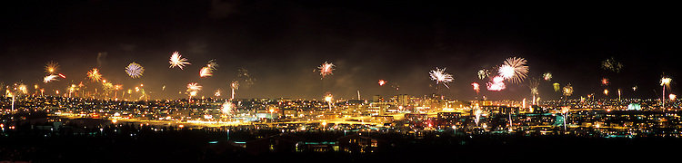 Icelandic new year celebration is like no other. Millions of dollars are spent each year on fireworks. Panorama images taken with Hasselblad Xpan camera and Fuji Velvia film.