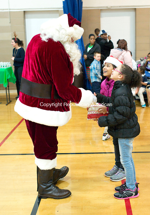 Waterbury, CT- 23 December 2015-122315CM09-  Santa visits with Ahmoni Terry, 10,  left, and Carmelina Terry, 8 from Marietta, GA at the Greater Waterbury YMCA on Wednesday.  The pair who were up visiting with family, attended the Christmas event, which was put on by the Greater Waterbury Interfaith Ministry.     Christopher Massa Republican-American