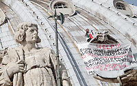 """Italian enterpreneur Marcello Di Finizio protests on St. Peter's dome at the Vatican, 3 October 2012. The banner reads """"Help!!! Enough Monti, Enough Europe, Enough multinationals. You're killing all of us. Development? This is just social butchery. No auctions. No Bolkestein. No M.E.S. - M.E.S: Stability for who?"""".UPDATE IMAGES PRESS/Riccardo De Luca"""