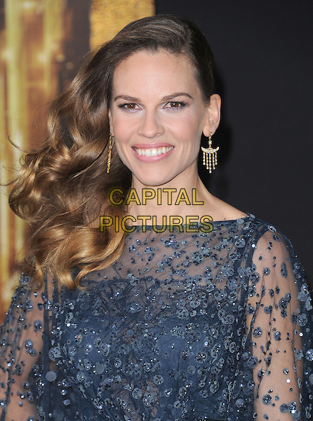 "Hilary Swank.The World Premiere of ""New Year's Eve' held at The Grauman's Chinese Theatre in Hollywood, California, USA..December 5th, 2011.headshot portrait black blue sheer beads beaded dangling gold earrings .CAP/RKE/DVS.©DVS/RockinExposures/Capital Pictures."