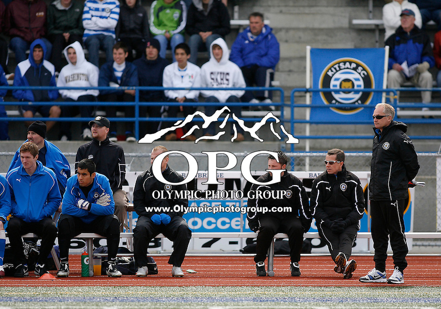 10 April 2010:   Kitsap Pumas head coach Peter Fewing watches his players form the bench against Gonzaga.  Kitsap won 2-0 in a friendly game against Gonzaga University at Bainbridge Island High School.