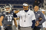 Nevada head coach Jay Norvell works the in first half of an NCAA college football game against New Mexico  in Reno, Nev., Saturday, Nov. 2, 2019. (AP Photo/Tom R. Smedes)