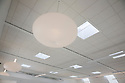 Skylights near energy efficient ceiling lights, turned on, in Integrated Design Associates office in San Jose, California, USA