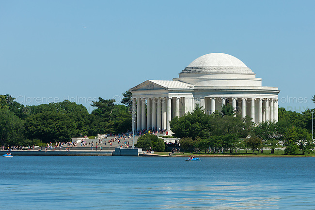 Tourists visit the Jefferson Memorial on the Tidal Basin on a spring day in Washington, DC.