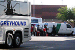 Border Patrol loading up their vans with arrested Undocumented Immigrant at a Greyhound Bus Station in Phoenix, AZ..Photo by AJ Alexander