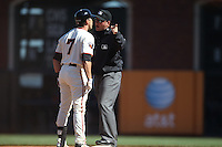 SAN FRANCISCO - AUGUST 28:  Mark DeRosa #7 of the San Francisco Giants argues with second base umpire Dan Bellino after being called out at second base during the game against the Houston Astros at AT&T Park on August 28, 2011 in San Francisco, California. Photo by Brad Mangin